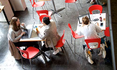 Students studying in a University of Manchester cafe.